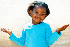 Wondering african girl with arms open. Stock Images