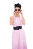 Wondering black hair model wearing sunglasses Stock Images