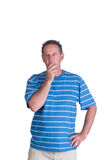 Wondering contemplating man. Middle aged white man in a blue striped shirt thinking or wondering and contemplating Royalty Free Stock Photography