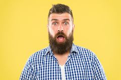 Wondering every time. Man bearded hipster wondering face yellow background close up. Guy surprised face expression. Hipster emotional surprised expression stock image