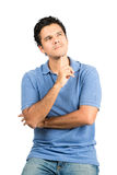 Wondering Hispanic Male Looking Up Arms Crossed. A handsome hispanic male in casual clothes with crossed arms, finger under chin, wondering, concentrating Royalty Free Stock Images