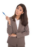 Wondering isolated business woman looking sideways to the text. Stock Photo