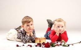 Wondering kids. Resting on the floor Royalty Free Stock Photos