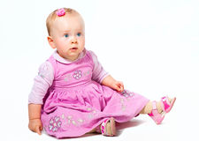 Wondering little girl on the floor isolated Royalty Free Stock Images