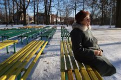 Wondering old woman... Beautiful old woman sitting on the bench in park Stock Images