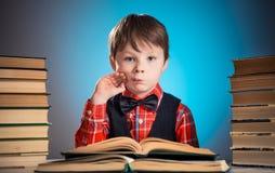 Wondering reader boy portrait Stock Image