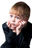 Wondering schoolboy face isolated on white Royalty Free Stock Photos