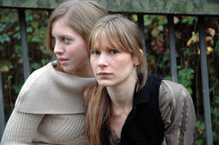 Wondering what's going on. Two young women looking confused royalty free stock images