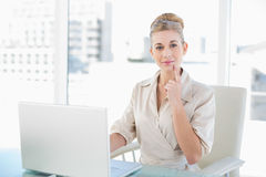 Wondering young blonde businesswoman looking at camera Royalty Free Stock Image