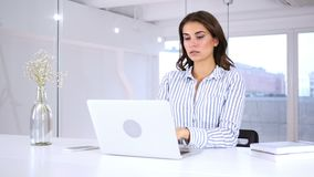 Wondering young woman gesturing shock at work, astonished