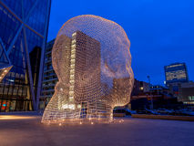 Wonderland sculpture, Calgary. CALGARY, CANADA - MAR 13: Wonderland sculpture by Jaume Plensa in the front of the Bow Tower on March 13, 2016 in Calgary, Alberta royalty free stock image