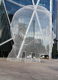 Wonderland sculpture by Jaume Plensa in the front of the Bow Tower in Calgary Stock Photo