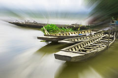 The wonderland of wooden boat float in reservoir with halo. Light for abstract background or mystery royalty free stock photography