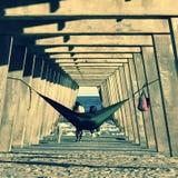 A wondrous hammock under a concrete pier on Tybee Island - GEORGIA - USA. Tybee Island is a barrier island and small city near Savannah, Georgia. It's known Royalty Free Stock Photo