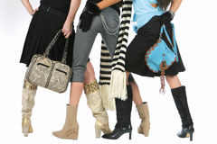 Wonem legs. Women legs with different shoes and bags Stock Photography