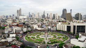 Wongwian Yai, the roundabout with buildings in Bangkok City, Thailand. Transportation concept. 4K cityscap. E VDO stock video