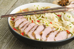 Wonton and Duck Noodle Soup. Wonton Noodle Soup - Chinese noodle soup with dumplings and sliced duck breast Royalty Free Stock Photos