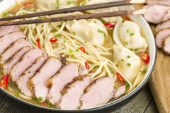 Wonton and Duck Noodle Soup. Wonton Noodle Soup - Chinese noodle soup with dumplings and sliced duck breast Royalty Free Stock Photo