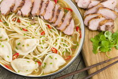 Wonton and Duck Noodle Soup. Wonton Noodle Soup - Chinese noodle soup with dumplings and sliced duck breast Royalty Free Stock Images