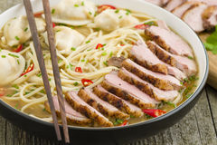 Wonton and Duck Noodle Soup. Wonton Noodle Soup - Chinese noodle soup with dumplings and sliced duck breast Stock Photos