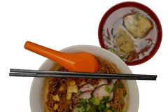 Wonton noodles. Is a Cantonese noodle dish which is popular in Guangzhou, Hong Kong, Malaysia, Singapore and Thailand. The dish is usually served in a hot broth royalty free stock photo