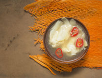 Wonton soup with chili on orange table deco Royalty Free Stock Photo