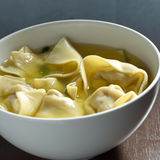 Wonton soup in a white bowl. Stock Photography