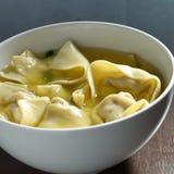 Wonton soup in a white bowl. Wonton soup in a white bowl shot closeup stock photography
