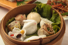 Wontons wrappers. In wooden bowl Royalty Free Stock Photos