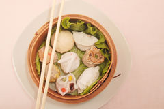 Wontons wrappers. In wooden bowl Stock Photos
