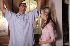 WOO HOO. Young husband that just learned his wife is pregnant Stock Images