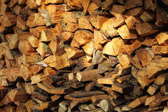 Wood. The heap of dry fire wood prepared for winter to heat the furnace Royalty Free Stock Image