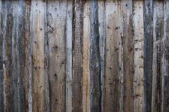 Wood. Rural fence from the old dampened boards Stock Image