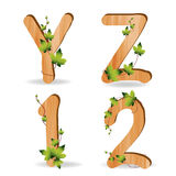 Wood alphabet with branch green leaves. Vector template design vector illustration
