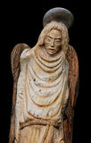 Wood Angel. Wood statue of angel isolated in black Stock Images