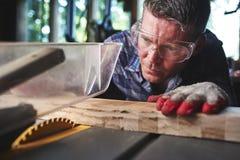 wood arbetare Arkivbild