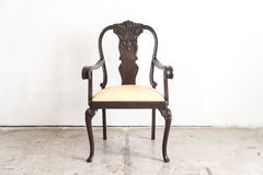 Wood armchair on white wall. Stock Images