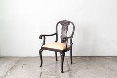 Wood armchair on white wall. Stock Photos