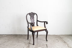 Wood armchair on white wall. Royalty Free Stock Photos