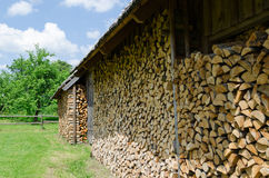 Wood arranged in shed village outdoor Royalty Free Stock Photo