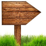 Wood arrow sign with grass isolated on a white Royalty Free Stock Photos