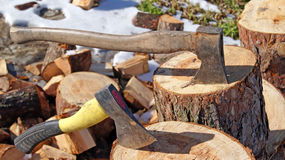 Wood axe and wood pile Stock Photos