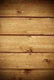 Wood background. Abstract background showing fragment of a wooden house wall facing with nails and wood texture. Portrait orientation Royalty Free Stock Image
