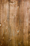 Wood background. Brown wood background with some knots royalty free stock images