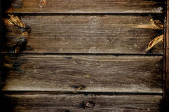Wood background. Old brown wood background with some knots stock photography