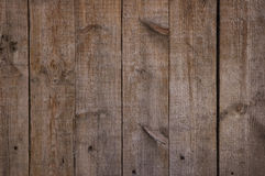 Wood background. Old brown wood background with some knots stock images