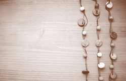 Wood background with beads Stock Images
