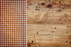 Wood background with checked napkin Stock Photo