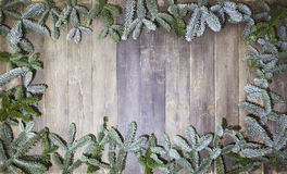 Wood background christmas branches. An old wooden background, decorated with pine branches, a Christmas background Royalty Free Stock Photo