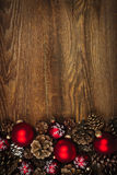 Wood background with Christmas ornaments. Rustic wood background with Christmas ornaments and pine cones Stock Photography